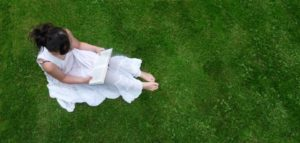 woman reading-pexels-woman on grass with book-woman in white dress