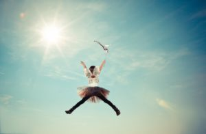 woman jumping-happy-joyful-sky-tutu