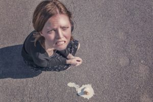 woman-dropped-fail-failure-ice cream-sad-crying
