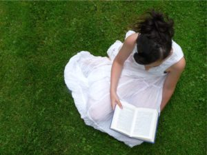 girl reading-woman reading-woman on grass-woman with book